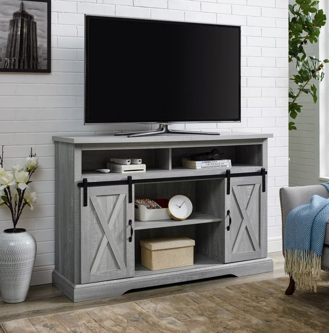 The light grey wood TV stand