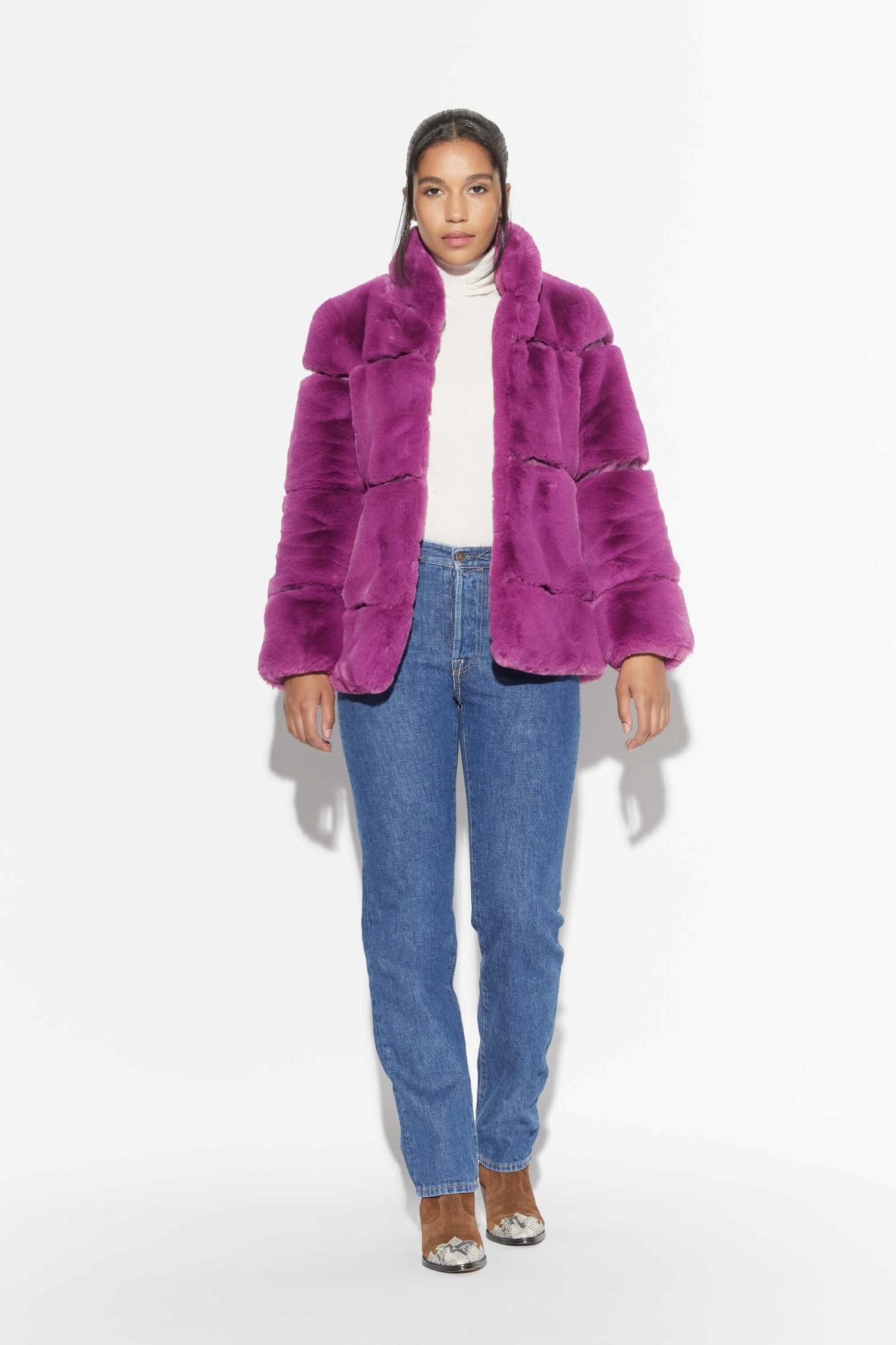model wearing purple furry coat