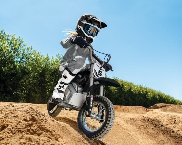 person rides on a razor electric motocross bike