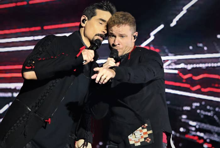 Brian Littrell and Kevin Richardson performing onstage
