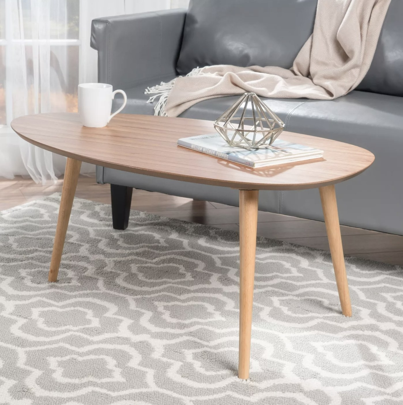 The light wood oval coffee table