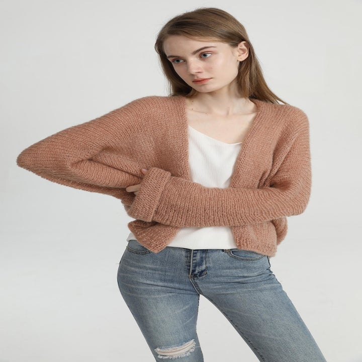 Front view of a model wearing the cardigan in maple sugar
