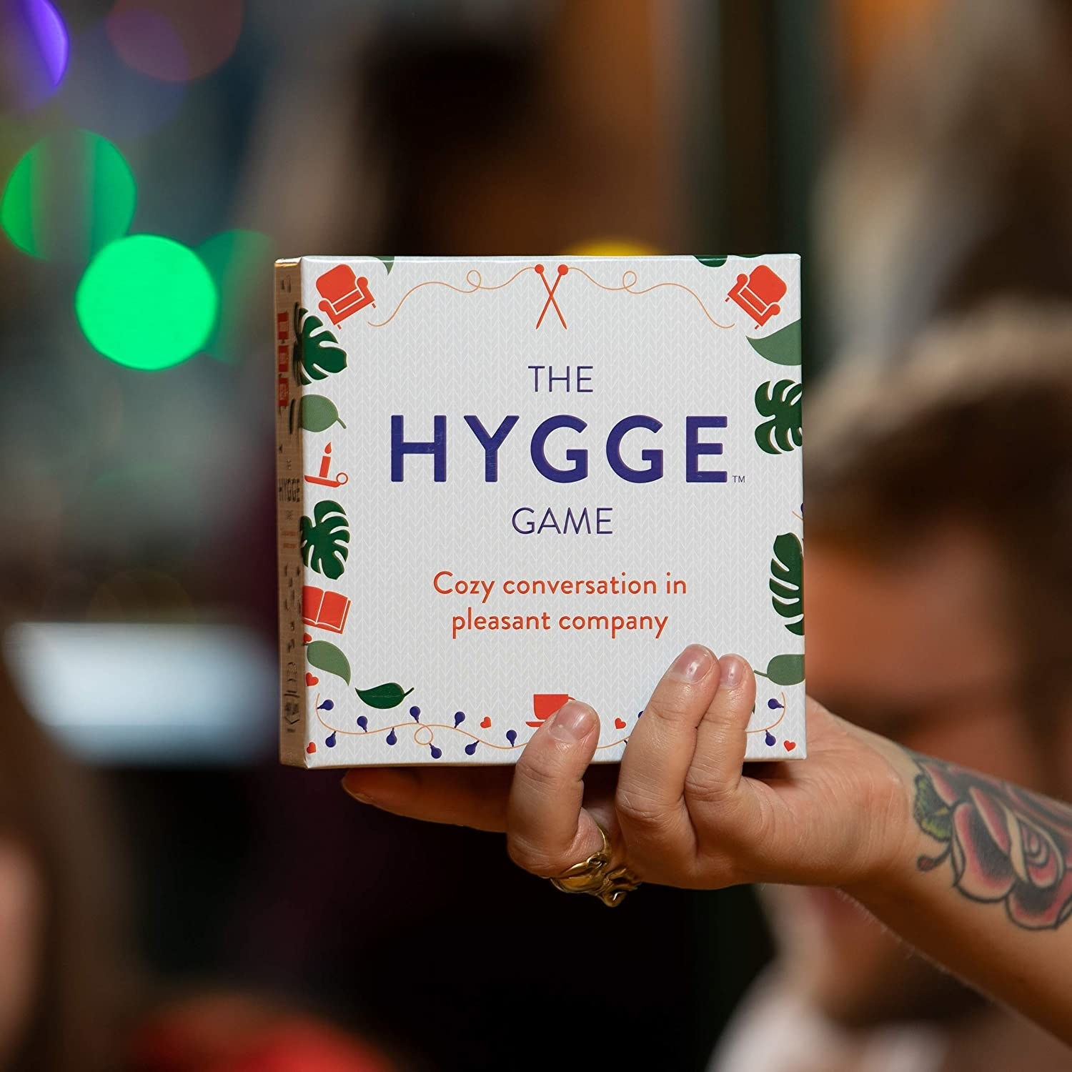 person holding the Hygge game box