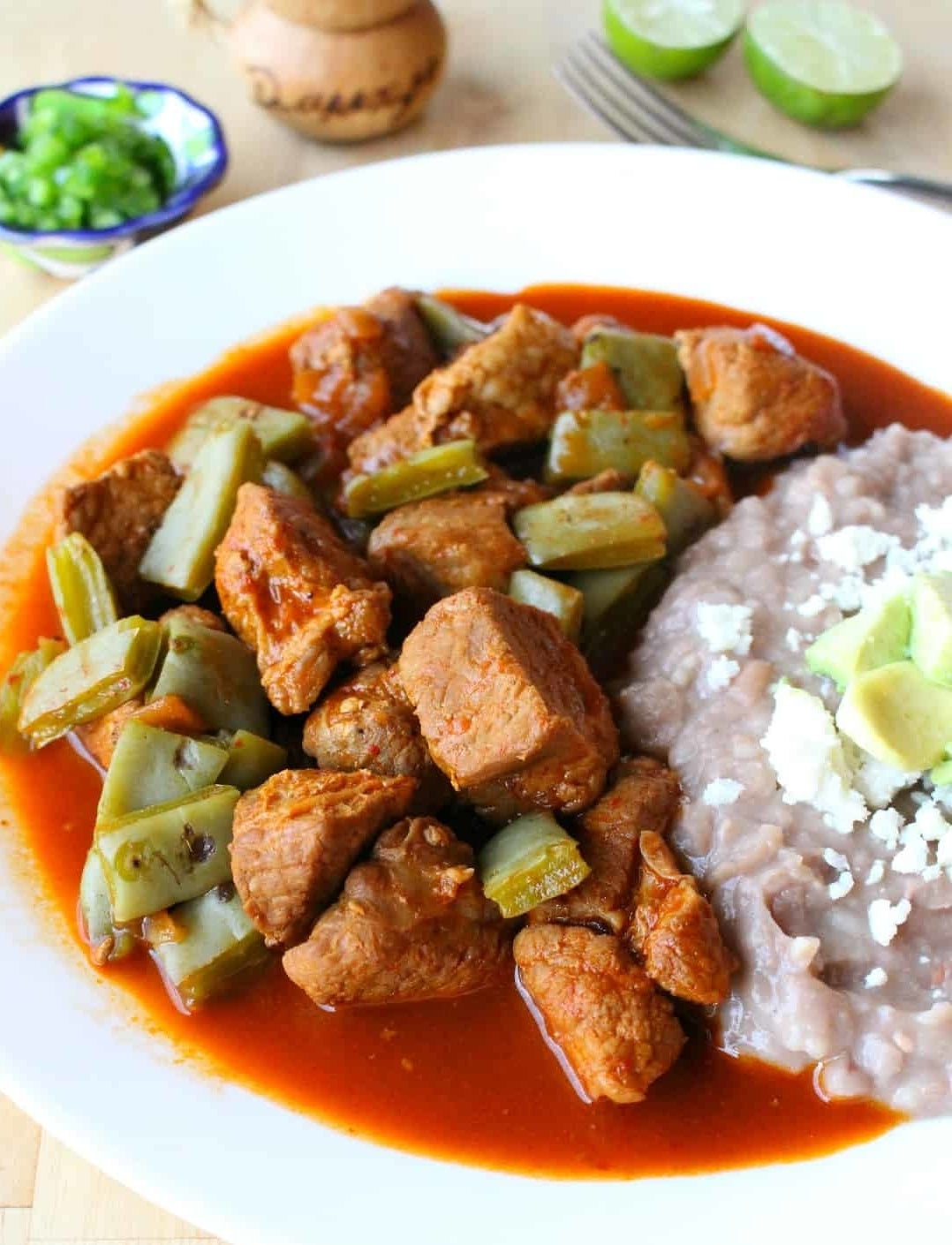 Pork chile with cactus and refried beans.