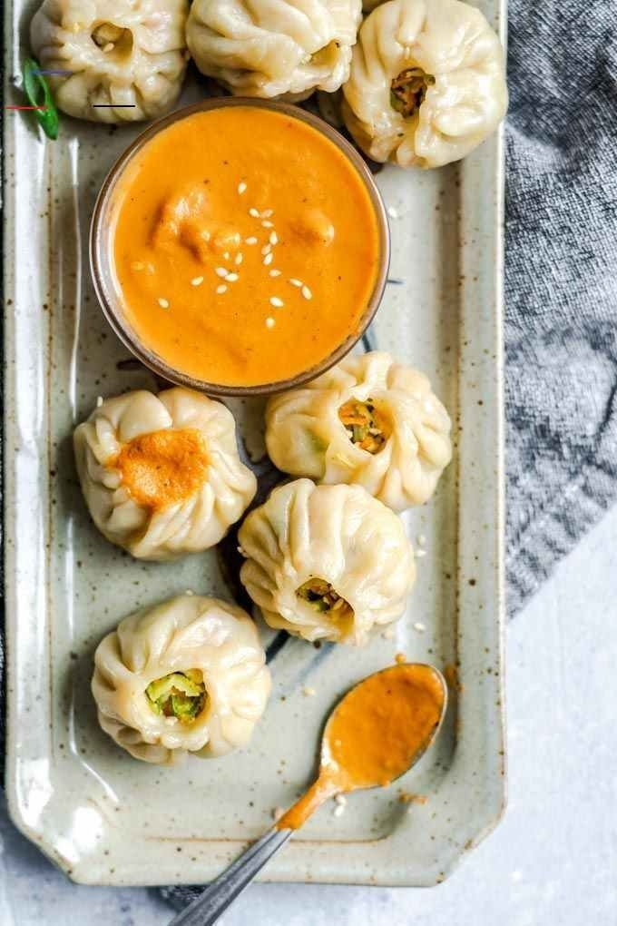 Vegetable-filled dumplings with tomato chutney on the side.