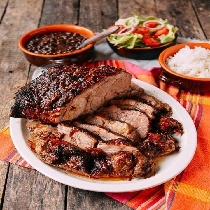 Pernil roast pork on a plate.
