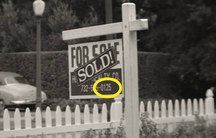 "A real estate sign with the numbers ""0125"" circled"