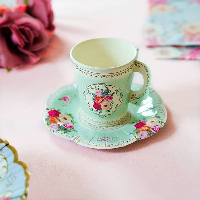 A paper teacup on a paper saucer