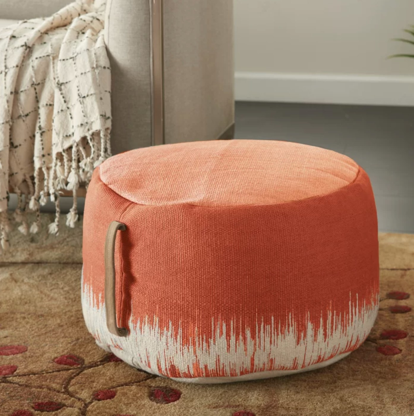 The round ottoman pouf in clay