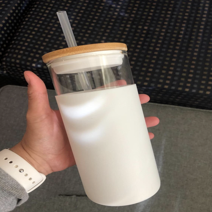 customer holds empty cup in white