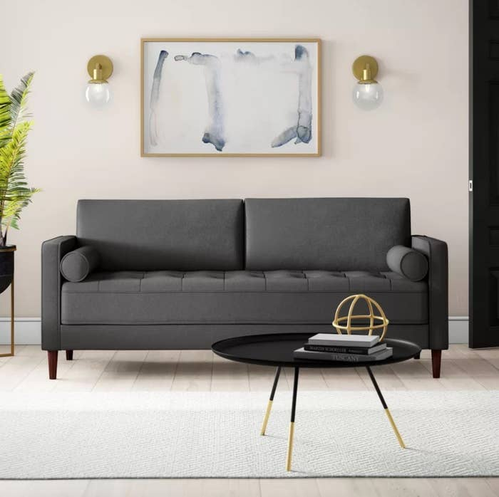 The square armed sofa in heather gray.