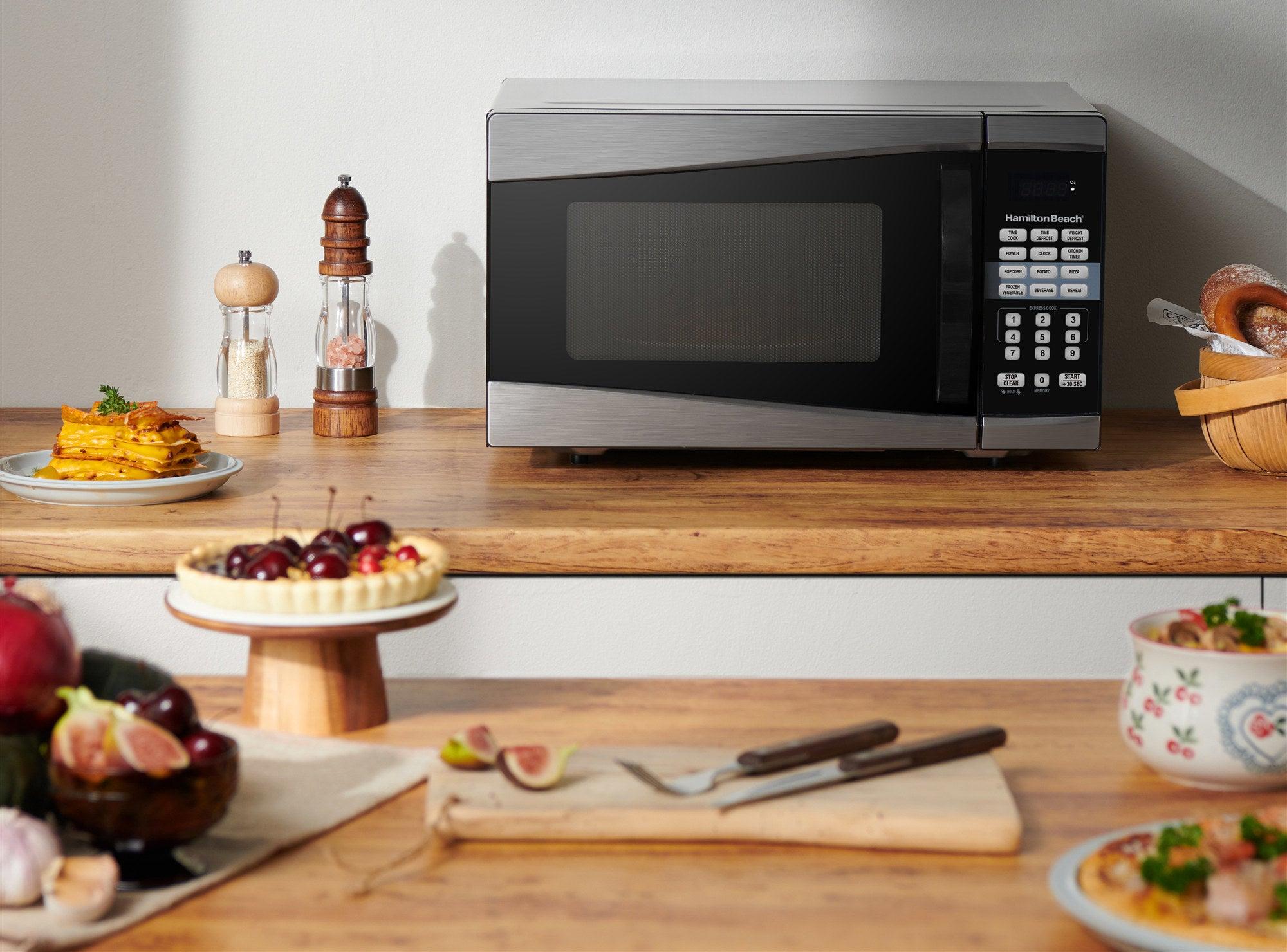 black hamilton beach microwave on a kitchen counter top