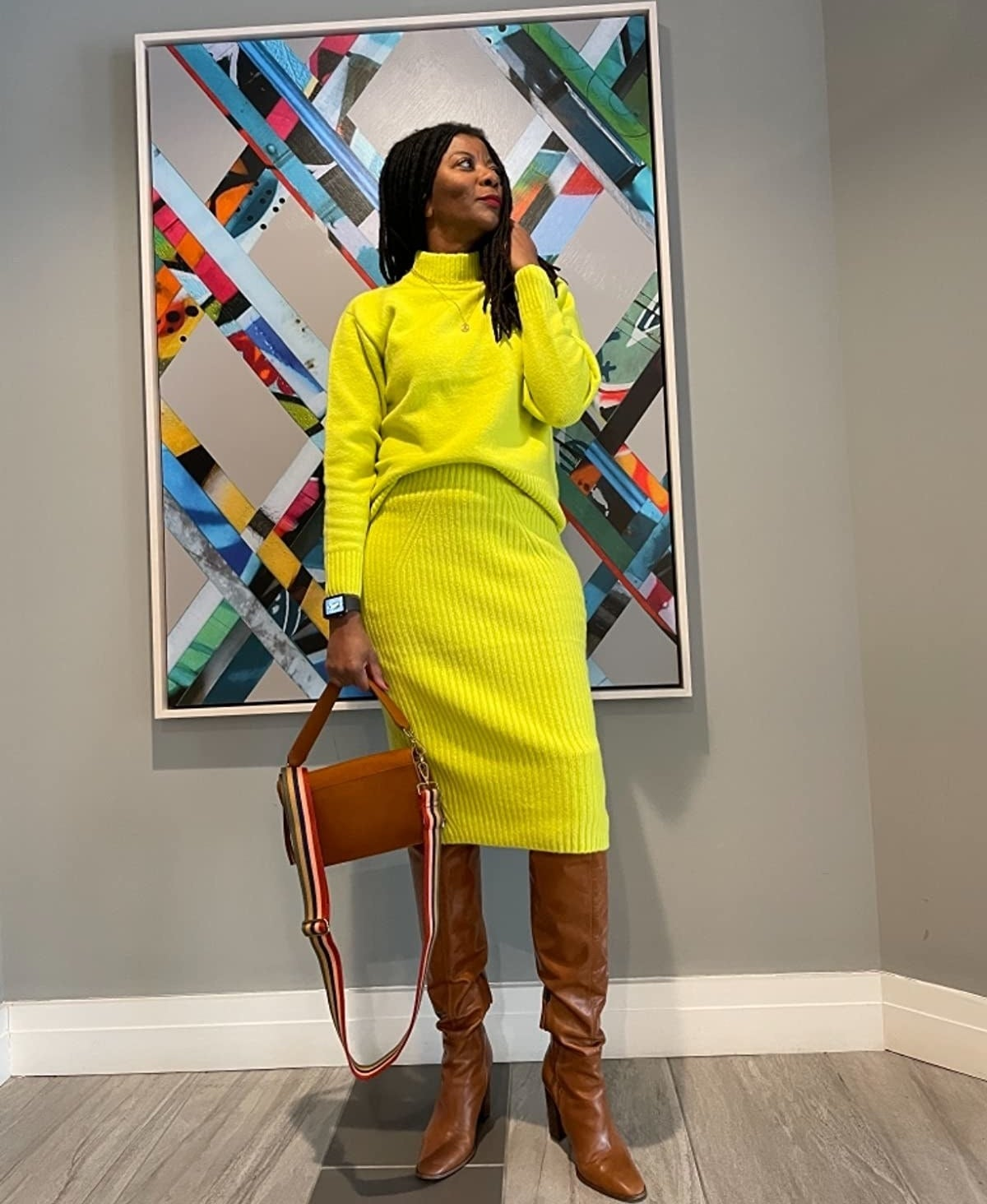 Reviewer wearing chartreuse-colored set
