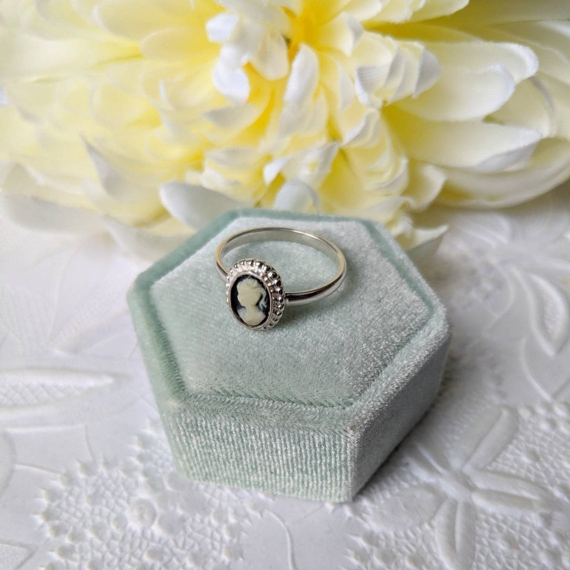 The cameo ring in its box