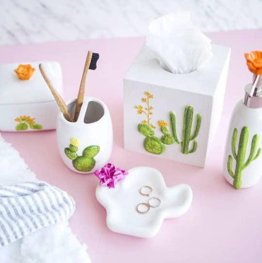 A flatlay of cactus-themed bathroom accessories