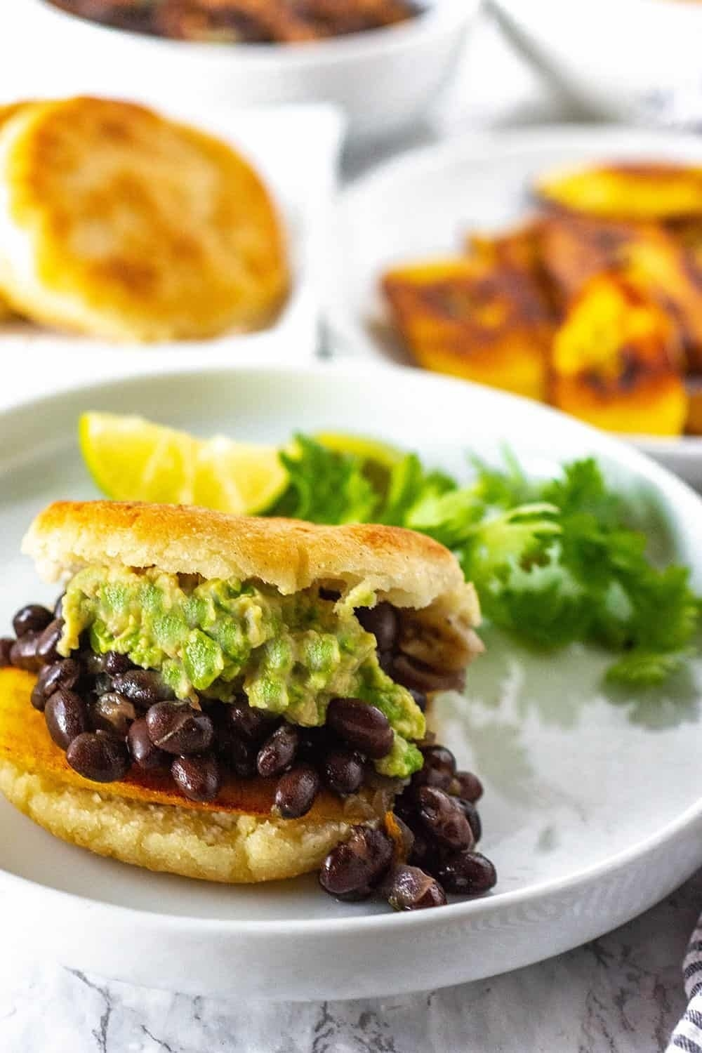 An arepa filled with beans and avocado.