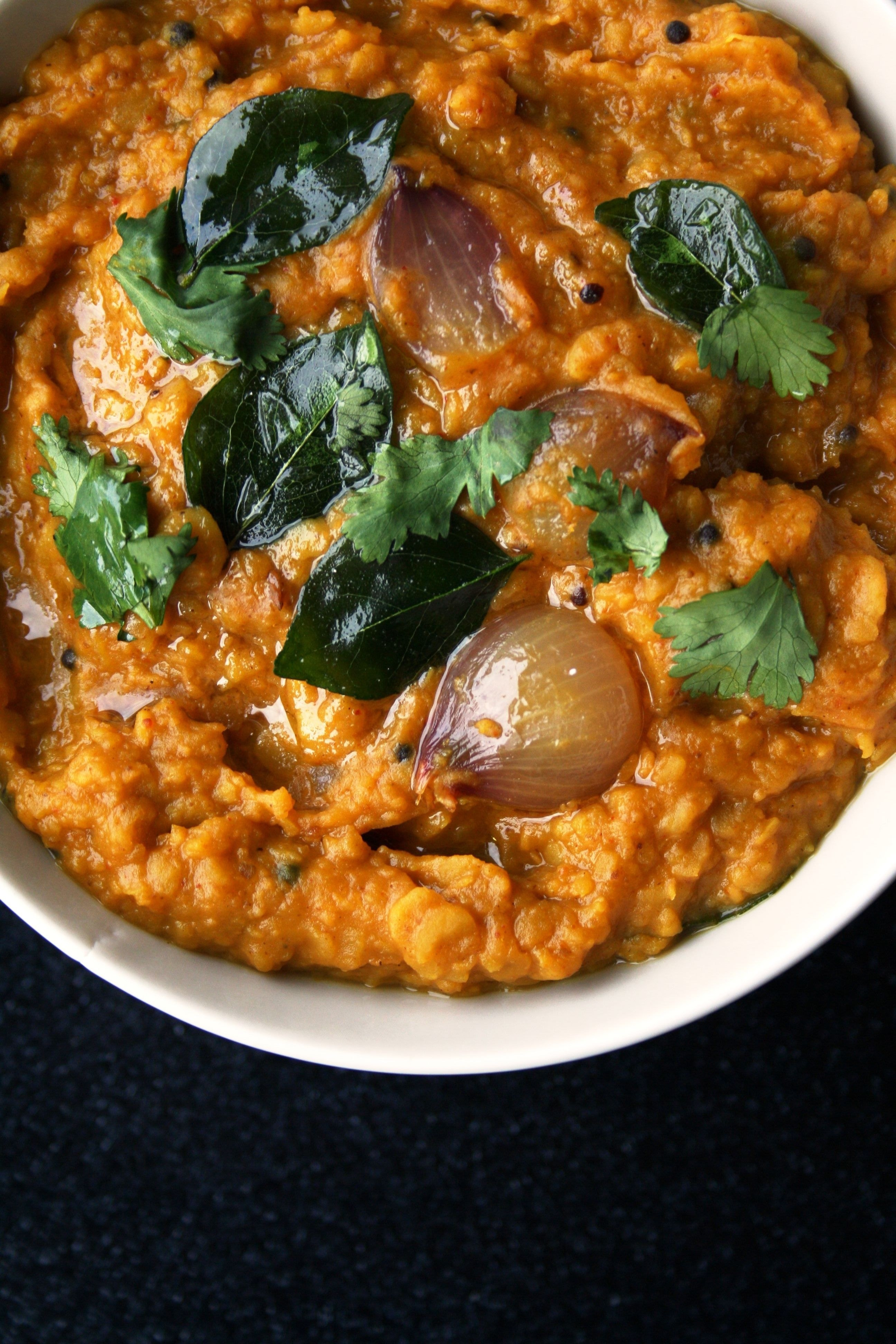 A bowl of lentil and vegetable curry.