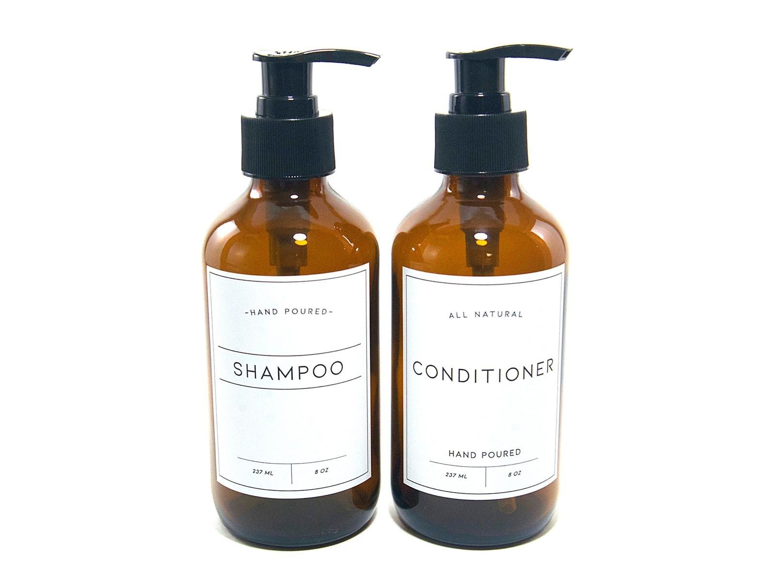 Two bottles of shampoo and conditioner with minimalist white labels