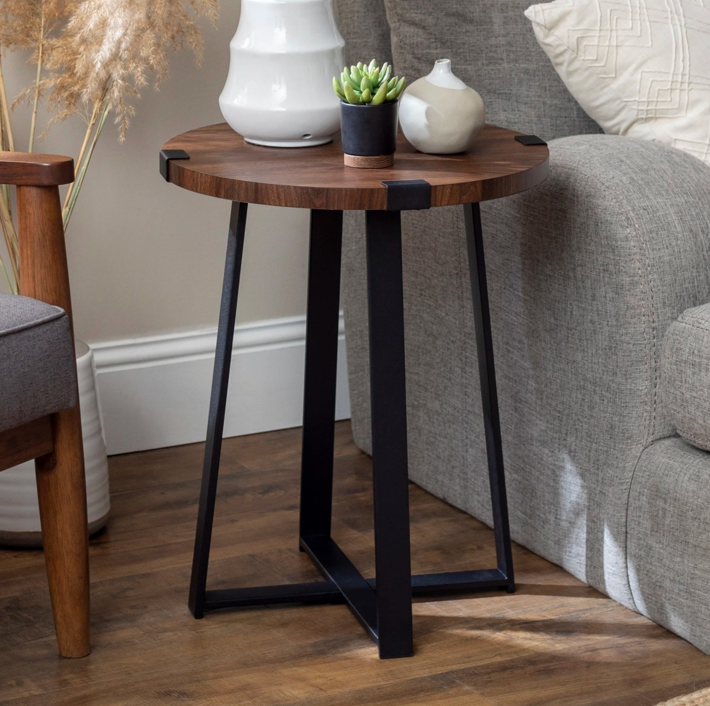The cross legs end table in dark walnut