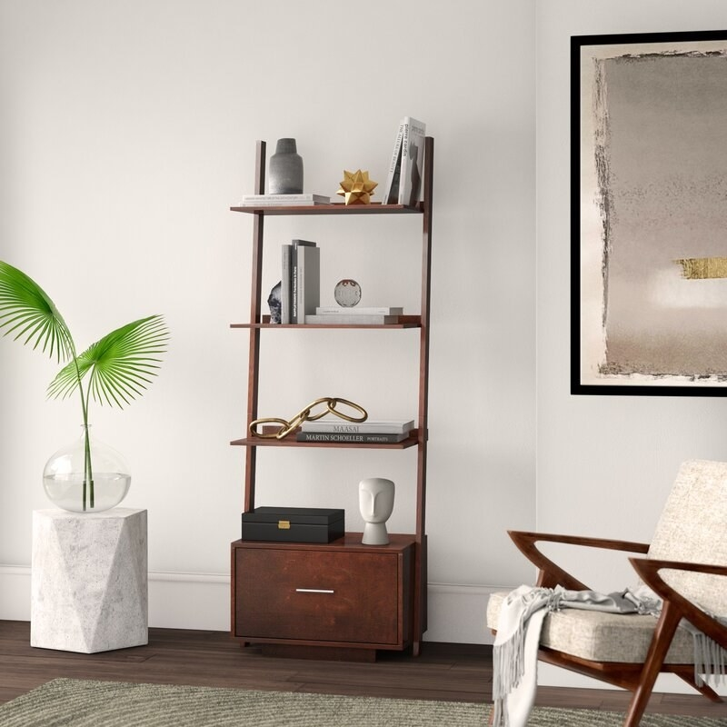 The ladder bookcase in dark brown
