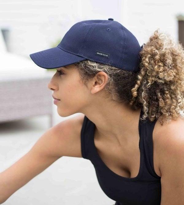 model wearing the baseball cap in navy blue