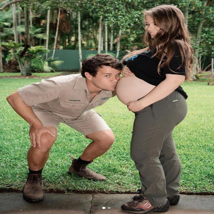 Charlie Powell kissing Bindi Irwin's pregnant belly