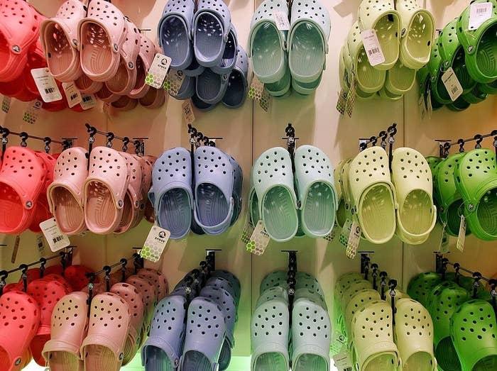A wall full of colorful Crocs