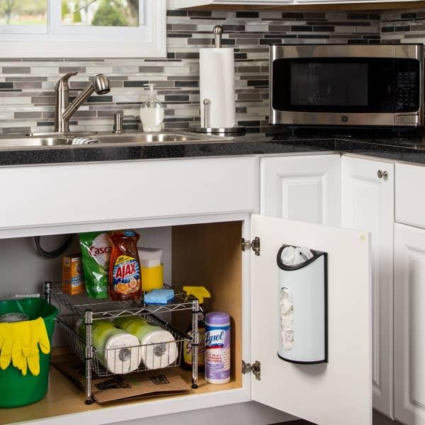 plastic bag dispenser mounted on a cabinet under the kitchen sink