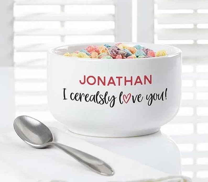 """The white cereal bowl that reads """"Jonathan I cerealsly love you!"""""""
