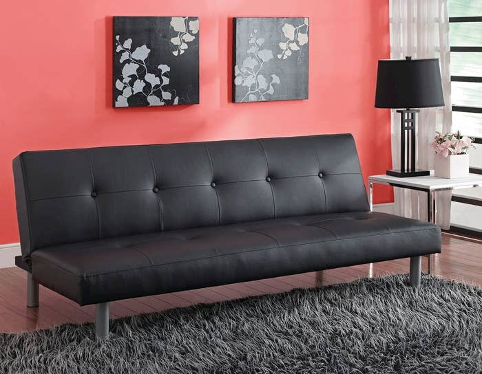 A black faux leather futon