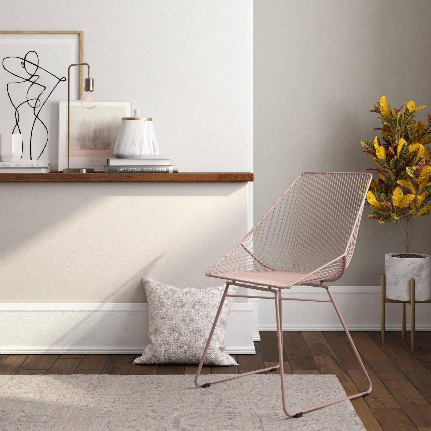 A blush metal accent chair
