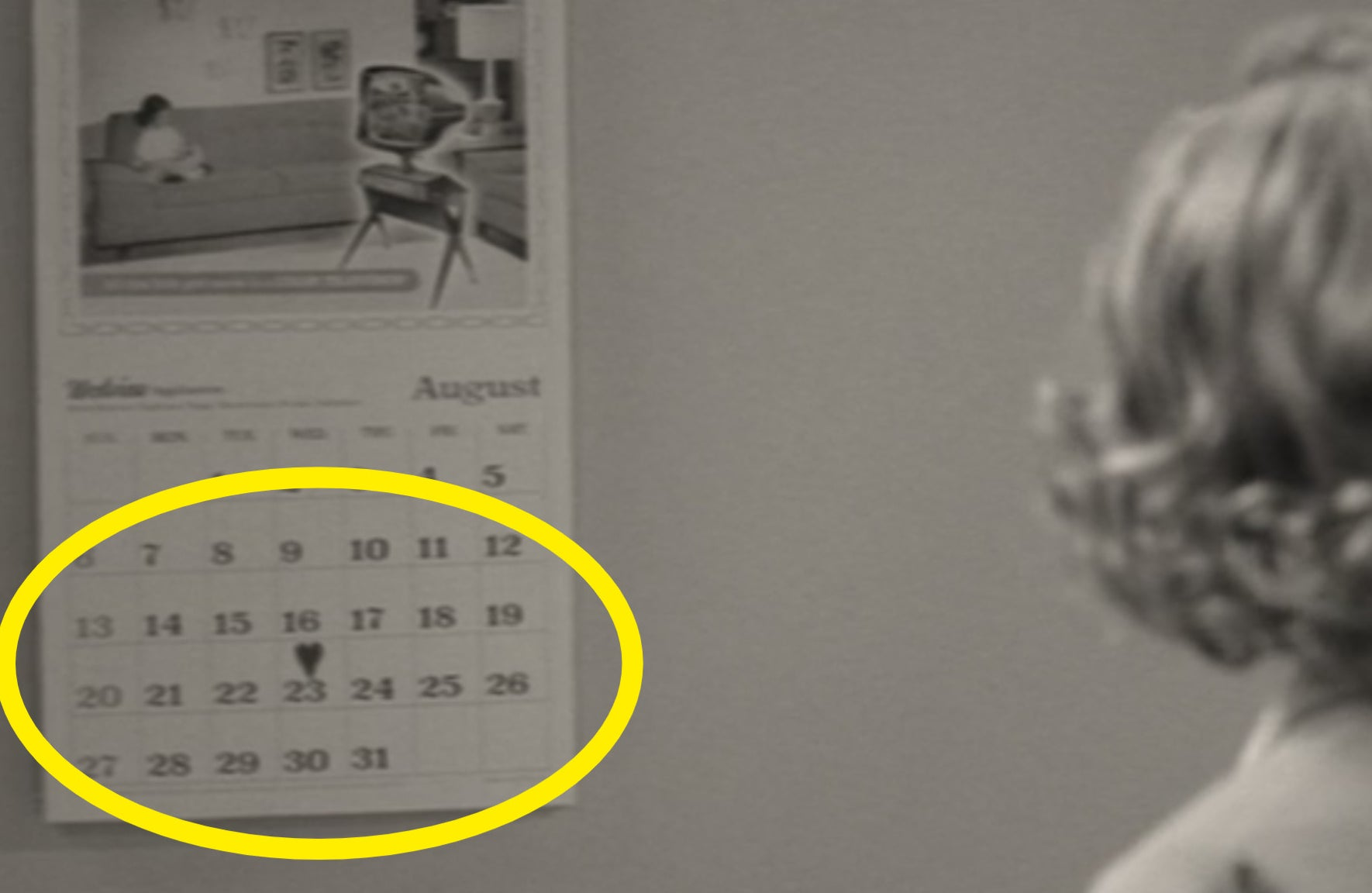 Wanda looking at a calendar with a heart on Aug. 23