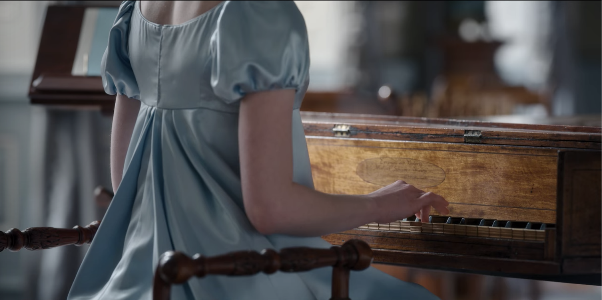 Daphne playing the pianoforte