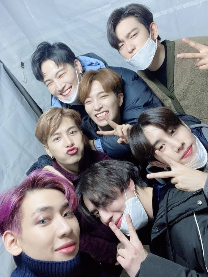 GOT7 smiles and poses together