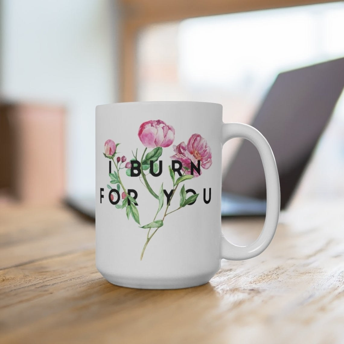 The mug on a table in front of a computer