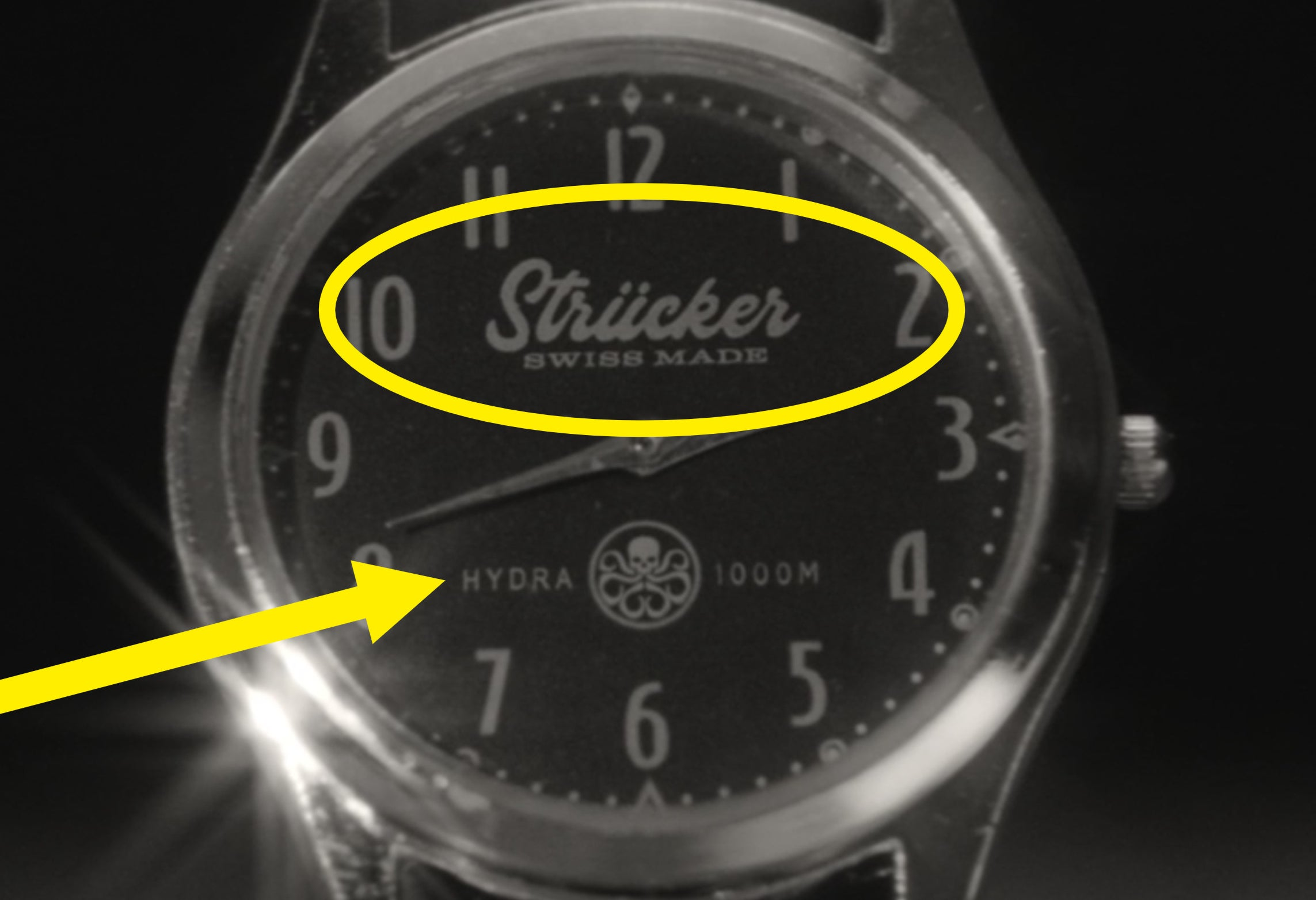 A close-up of the Strucker watch that also says Hydra and has the Hydra logo