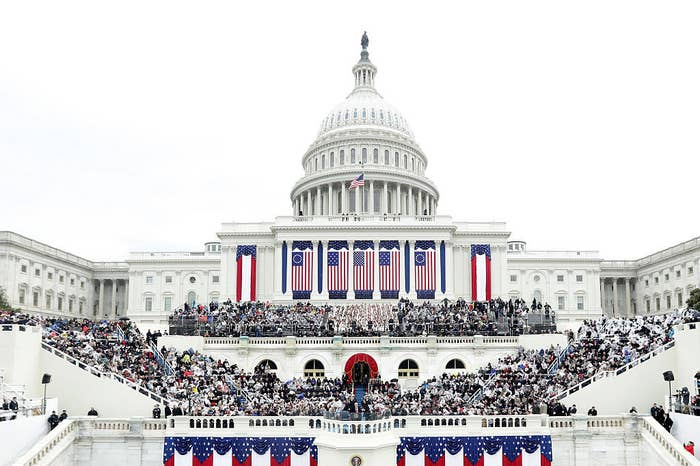Invited guests sitting at the Capitol inauguration on a clear day no social distancing