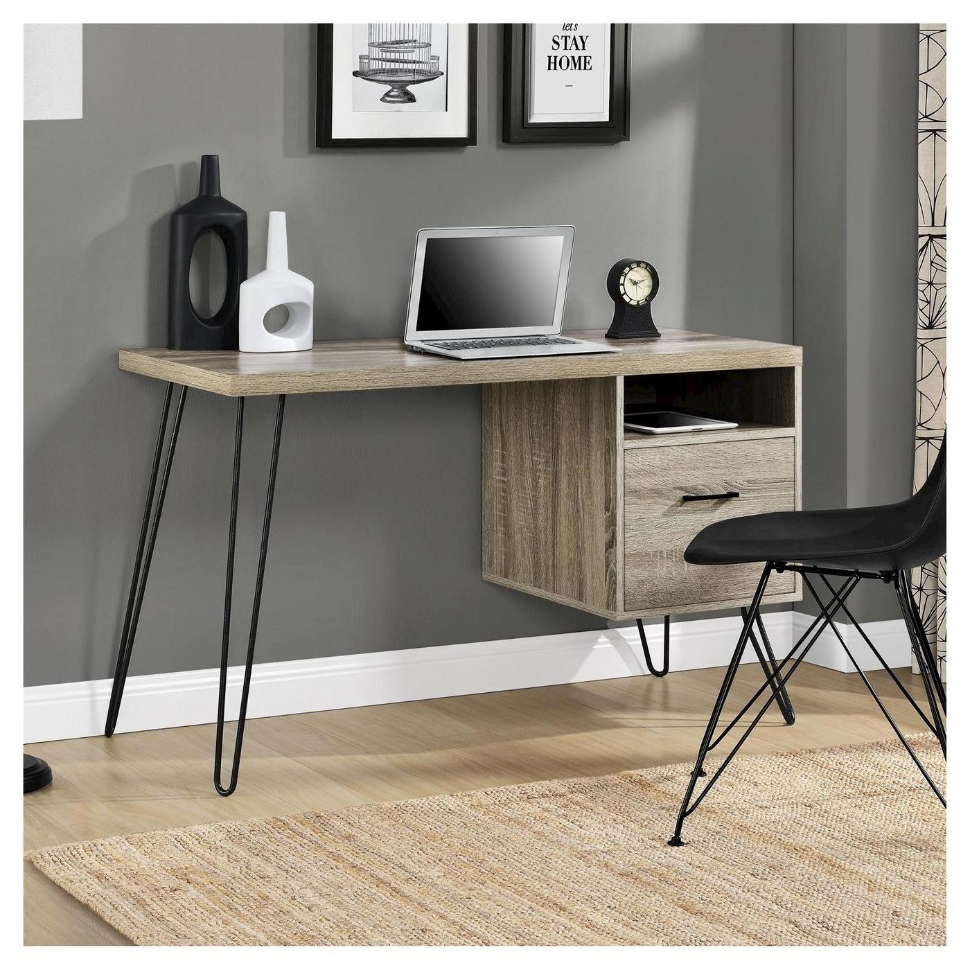 A writing desk with hairpin metal legs