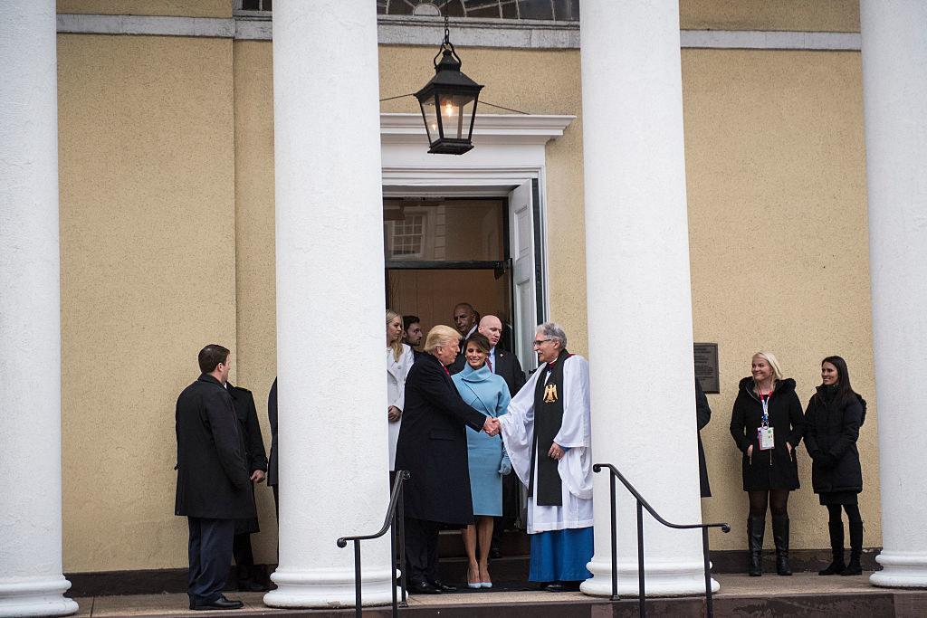 Donald Trump greeting a clergyman as Melania Trump looks on