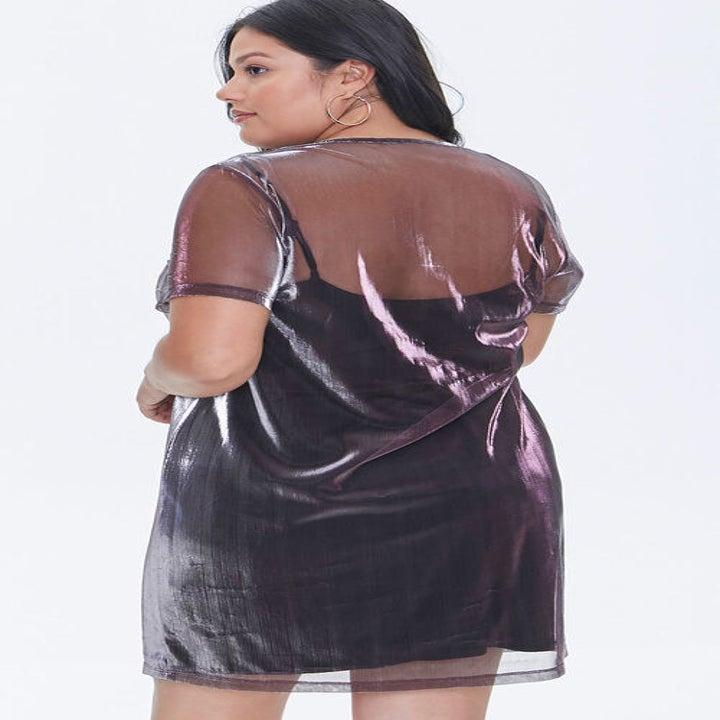 Back view of a model wearing the dress in purple/multi
