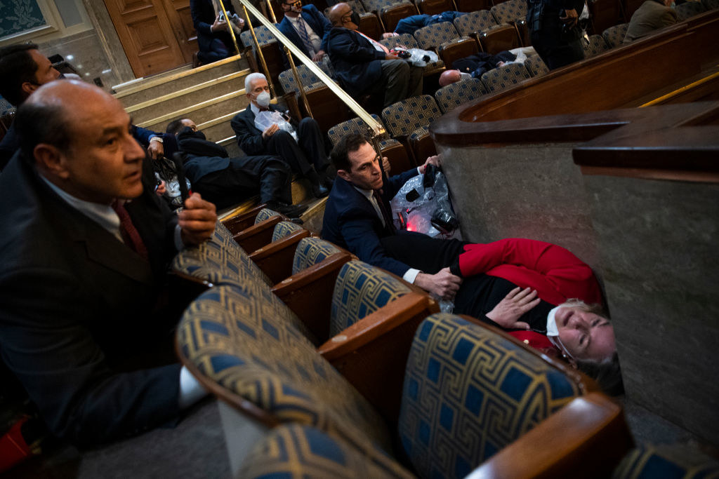 Members of Congress check on in each other's safety as the terrorists breached the Capitol