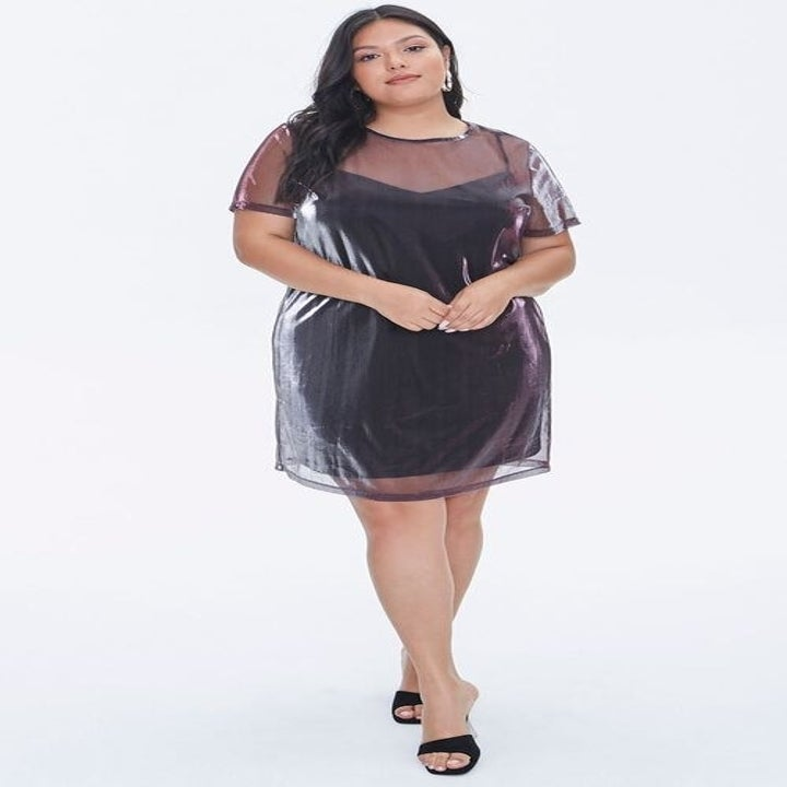 Front view of a model wearing the dress in purple/multi