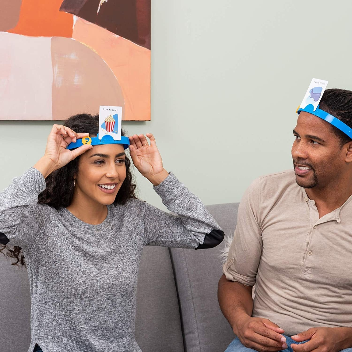 person with a popcorn image on her head and a player next to her looking at it