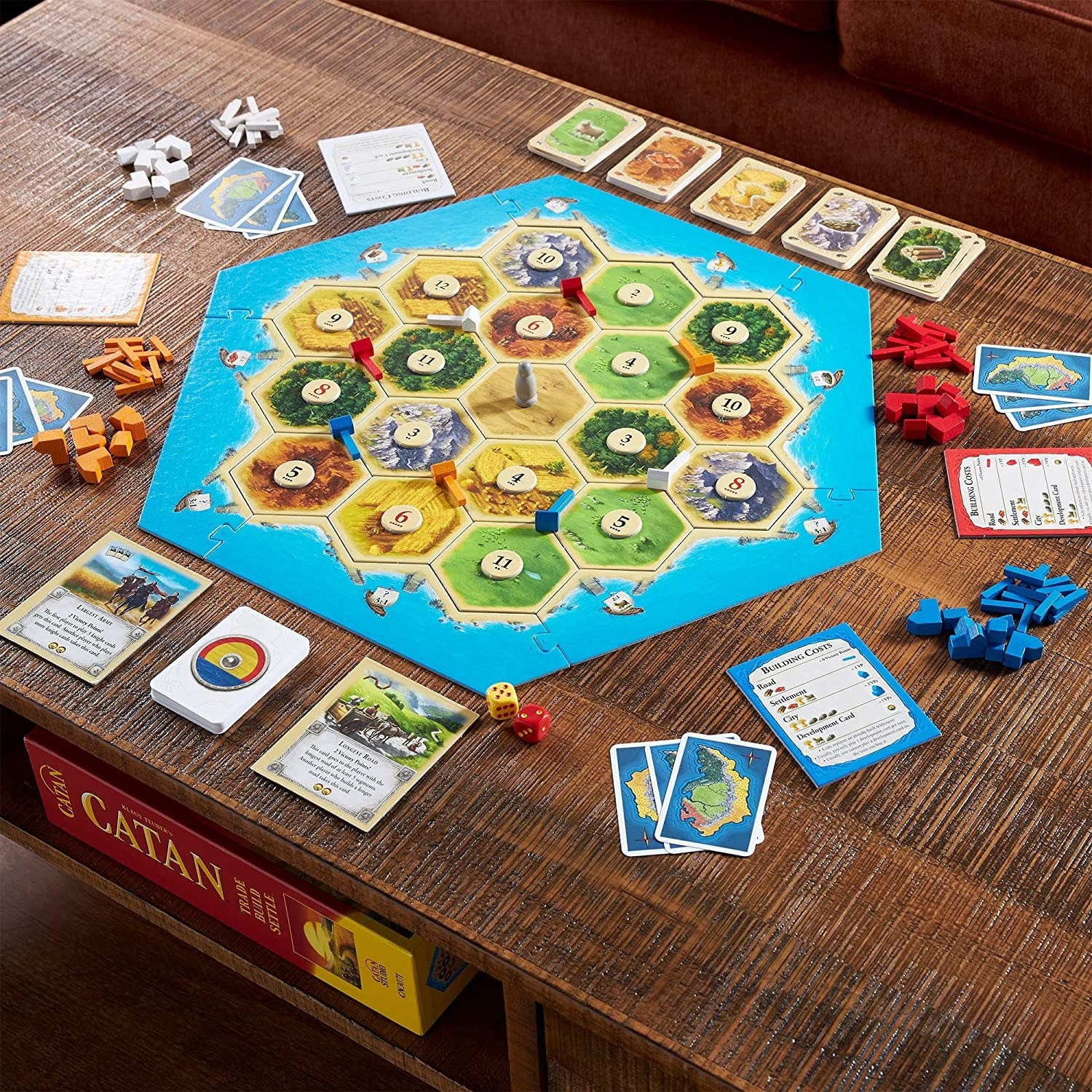 the catan board set up with chips and cards