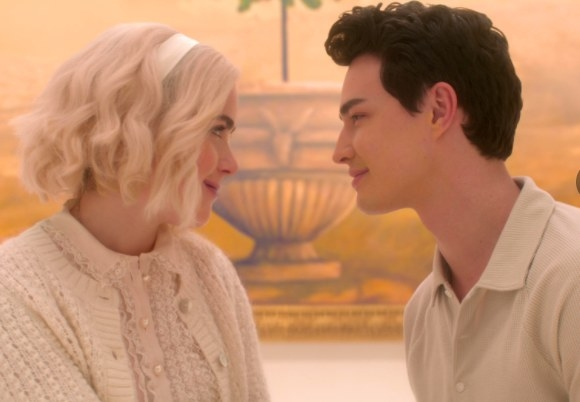 Sabrina and Nick staring lovingly at each other