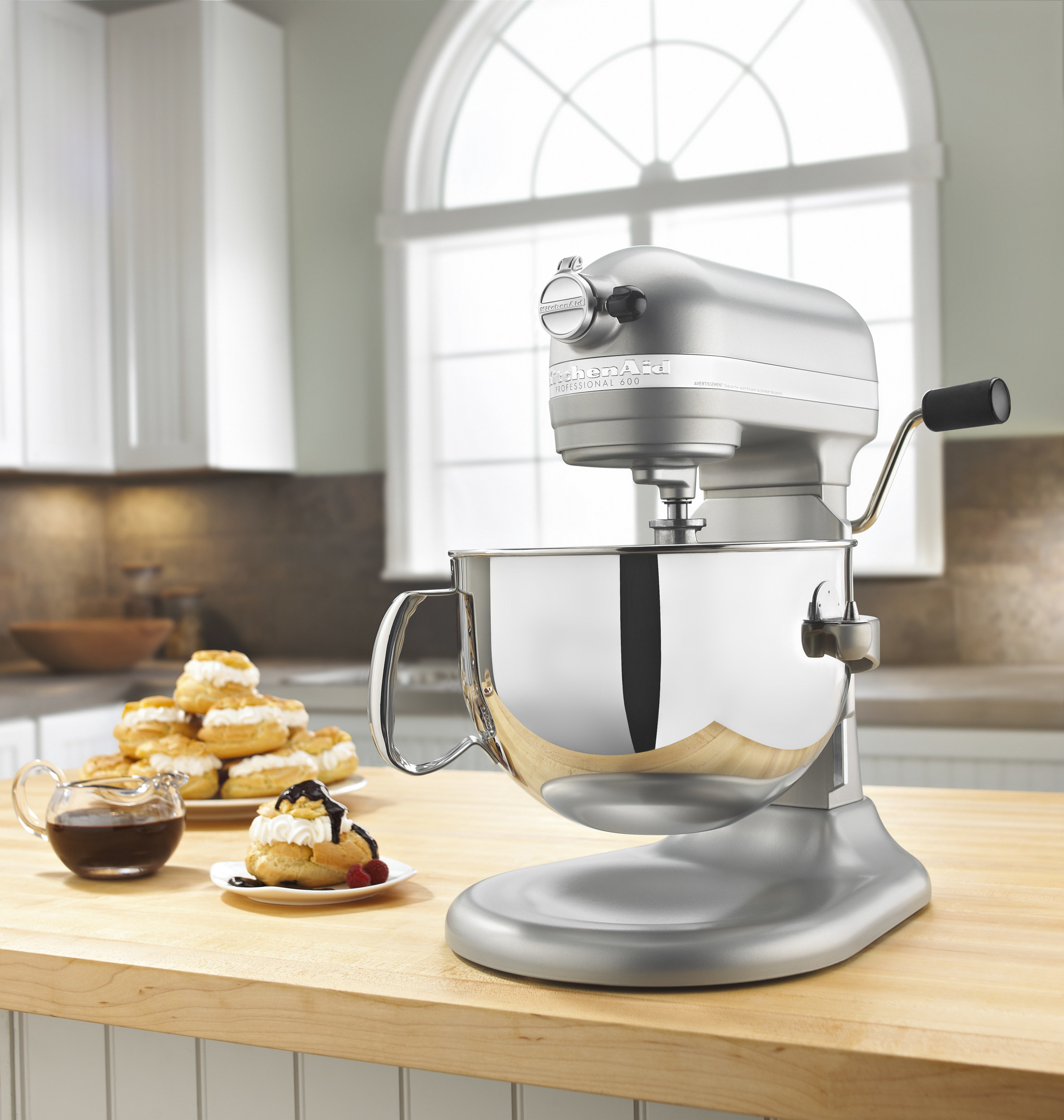 the mixer in gray next to baked goods
