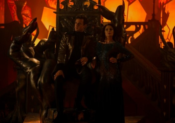 Lilith stands next to Lucifer sitting on his throne