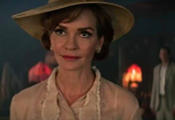 Prudence disguised as Penelope Blossom, wearing a blouse a hat