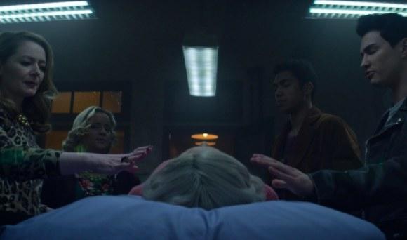 Zelda, Hilda, Ambrose, and Nick stand over Sabrina's body
