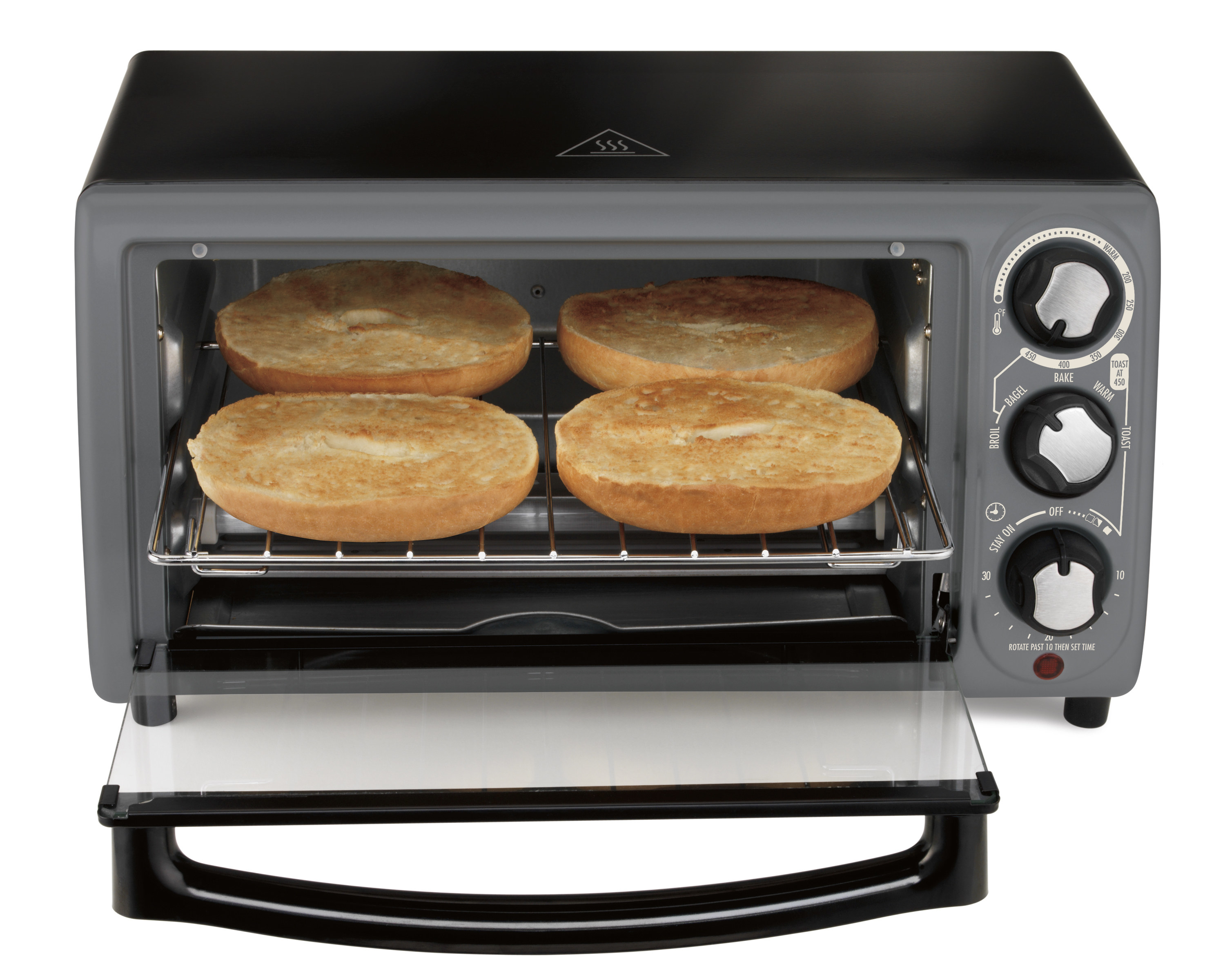 the toaster oven with bagels toasting inside